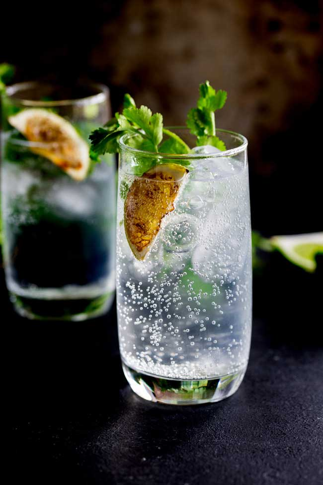 Fresh Herb Summer Cocktail Recipes - Charred Lime Gin and Tonic with Cilantro by Sprinkles & Sprouts