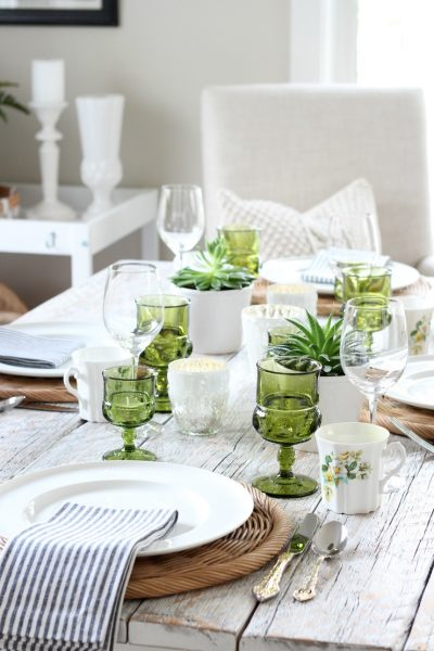 See how I set this eclectic fall tablescape using vintage green glassware, thrifted floral mugs, pretty gold flatware and other beautiful decor pieces!