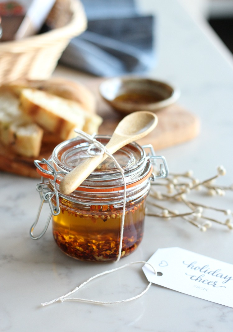 This homemade chili and garlic flavoured olive oil is an easy holiday appetizer or handmade gift idea. Whip up a jar to take along to your next Christmas party.