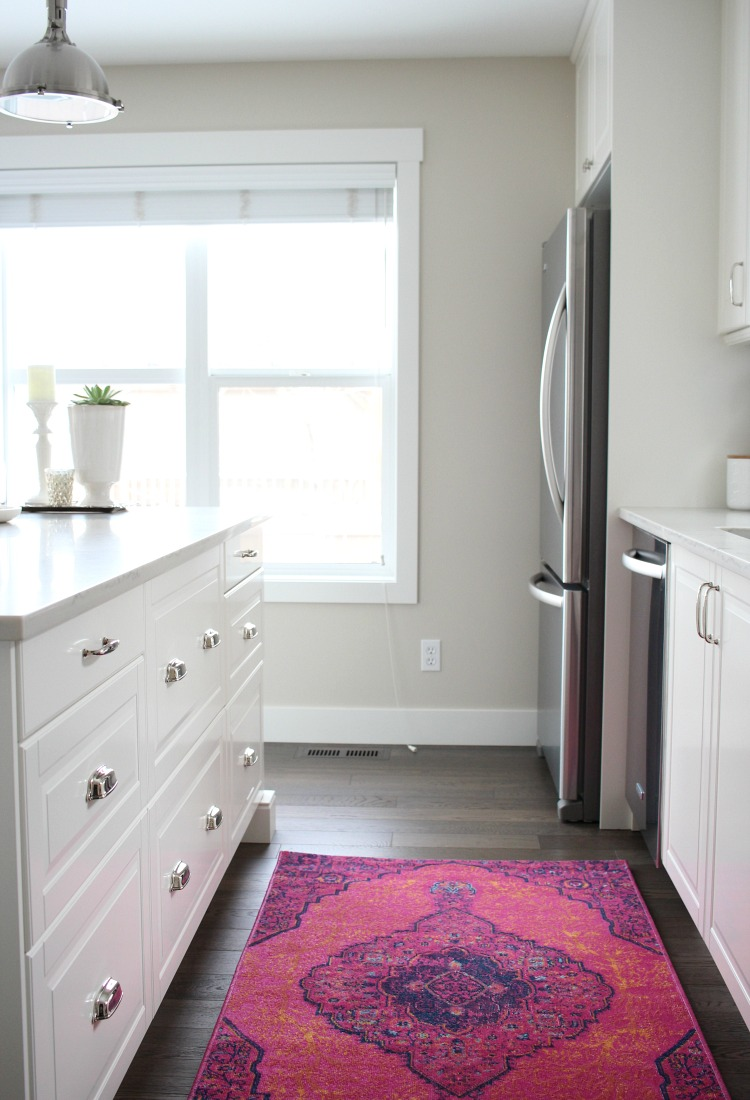 Christmas Home Tour - Bright Pink Patterned Rug in the Kitchen - Satori Design for Living
