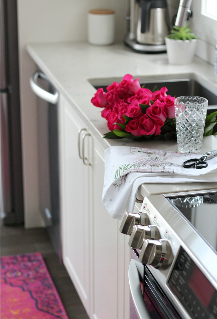 Christmas Home Tour with Bright Pink Flowers and Patterned Rug in the Kitchen - Satori Design for Living