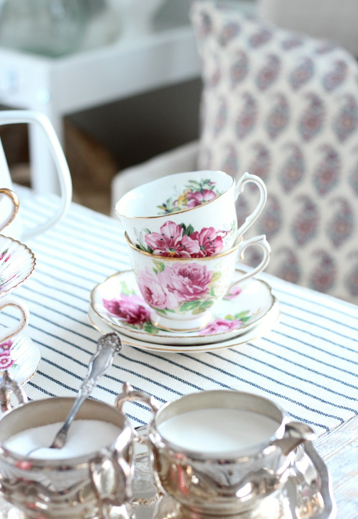 Decorating with Thrift Store Finds - Table Setting with Vintage Pink Floral Tea Cups and Silver Cream and Sugar Set