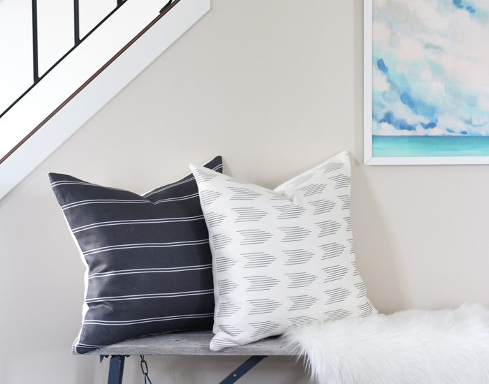 Rustic Bench Styled with Pillows, Oversized Art and Faux Sheepskin