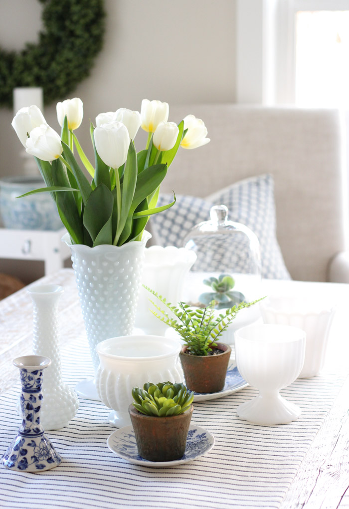Spring Table Centerpiece with Potted Plants and Milk Glass Vases